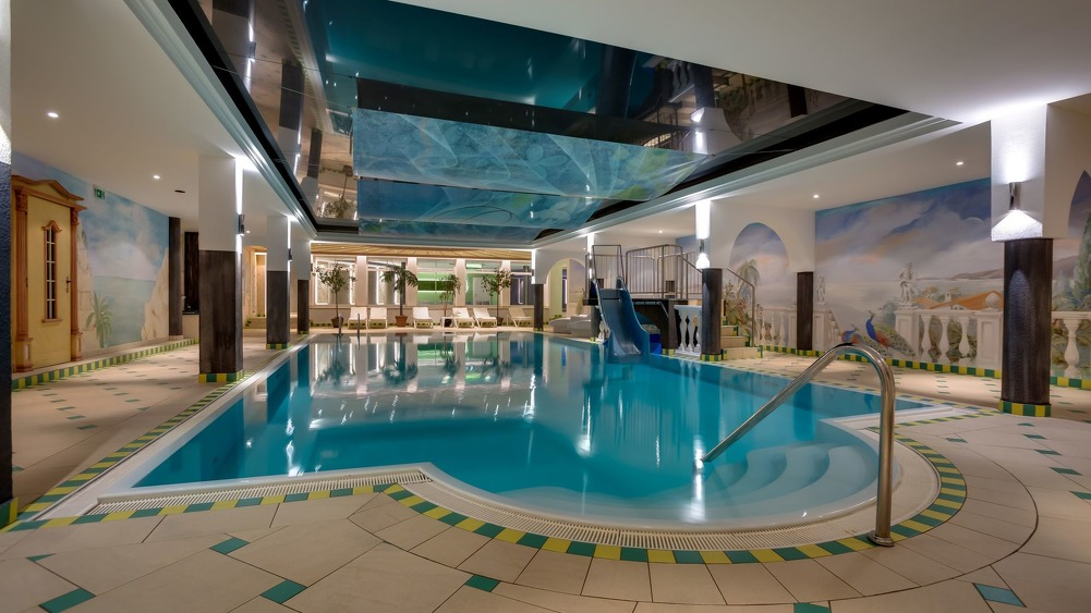 Indoor family pool with waterslide